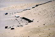 Nomadic herding livestock farming with shade tent for camels, sheep and goats in desert, Saudi Arabia 1979