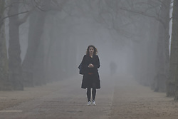 © Licensed to London News Pictures. 03/03/2021. London, UK. An early riser walks along The Mall in fog in central London. Later Chancellor Rishi Sunak will deliver his budget to Parliament. Photo credit: Peter Macdiarmid/LNP