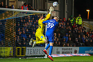 AFC Wimbledon striker Joe Pigott (39) challanges Peterborough United goalkeeper Conor O'Malley (25) for the ball during the EFL Sky Bet League 1 match between AFC Wimbledon and Peterborough United at the Cherry Red Records Stadium, Kingston, England on 12 March 2019.