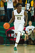 WACO, TX - JANUARY 24: Taurean Prince #21 of the Baylor Bears brings the ball up court against the Oklahoma Sooners on January 24, 2015 at the Ferrell Center in Waco, Texas.  (Photo by Cooper Neill/Getty Images) *** Local Caption *** Taurean Prince
