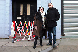 © Licensed to London News Pictures. 22/12/2013. London, UK. Local business owners Jill Farbey and Yuval Hen General (who rent space in Studio Spaces and say their businesses are being ruined by the rave events) stand outside to Unit 10, Studio Spaces in Pennington Street, East London after being called by Police in the early hours. Around 16 emergency vehicles attended an incident in the early hours of 22 December 2013 where a 'Santa Stamp' rave event was being held and two people were stabbed, windows were broken and objects were thrown from windows on the top floor. Photo credit : Vickie Flores/LNP