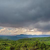 A thundershower rolls across forests on Cedar Mesa in a part of southeastern Utah that was part of  Bears Ears National Monument before it was downsized by the Trump administration in 2017.