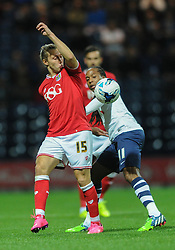 Luke Freeman of Bristol City jostles for the ball with Daniel Johnson of Preston North End - Mandatory byline: Dougie Allward/JMP - 07966386802 - 15/09/2015 - FOOTBALL - Deepdale Stadium -Preston,England - Bristol City v Preston North End - Sky Bet Championship