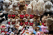 Teddy bear stall on Pettycoat Lane Market in the City of London on 2nd February 2020 in London, England, United Kingdom. Petticoat Lane Market is a fashion and clothing market in the East End of London. It consists of two adjacent street markets. Wentworth Street Market is open six days a week, and Middlesex Street Market is open on Sunday only. The name Petticoat Lane came from not only the sale of petticoats but from the fable that they would steal your petticoat at one end of the market and sell it back to you at the other.