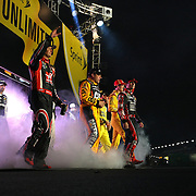 The NASCAR race car drivers are introduced to the crowd prior to the NASCAR Sprint Unlimited Race at Daytona International Speedway on Saturday, February 15,  2014 in Daytona Beach, Florida.  (AP Photo/Alex Menendez)