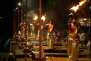 """Varanasi, India. Friday 16 March.The """"Ganga Aarti"""" ceremony which takes place every evening at the Dasaswamedh Ghat in Varanasi, one of the holiest cities in India which is situated on the western bank of the Ganges River and attracts Hindu pilgrims from across the Globe who come to the Varanasi ghats (steps) to bathe in the waters of Ma Ganga..  Alongside the bathing ghats are also """"burning ghats"""" where bodies are cremated in public, the ashes then given to the waters..     The Ganges river is 1557 miles long and stretches from the Himalayas to the Indian Port of Calcutta, supplying water to one twelth of the worlds population. ."""