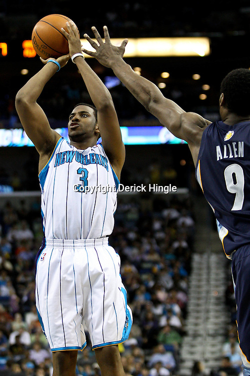April 1, 2011; New Orleans, LA, USA; New Orleans Hornets point guard Chris Paul (3) shoots over Memphis Grizzlies shooting guard Tony Allen (9) during the second half at the New Orleans Arena. The Grizzlies defeated the Hornets 93-81.   Mandatory Credit: Derick E. Hingle