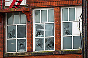"""Oldham, United Kingdom, June 21, 2021: Some dindows appears to be broken following the arrest of Palestine Action activists who scaled the roof of """"Cairo House"""" in Oldham on Monday, June 21, 2021. This is the ongoing protest forms of the human rights activists group in Britain targeting an Israeli owned weapons manufacturer Elbit Systems. Activists argue that arms being manufactured in the facility are being used in indiscriminate attacks against the Gaza Strip. (VX Photo/ Vudi Xhymshiti)"""