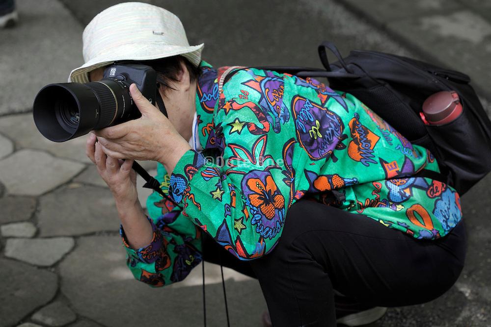senior woman taking pictures