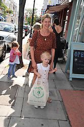 SARA PARKER-BOWLES and her daughter LOLA at the opening of the new HoneyJam children's store at 2 Blenheim Crescent, London W11 on 7th July 2011.