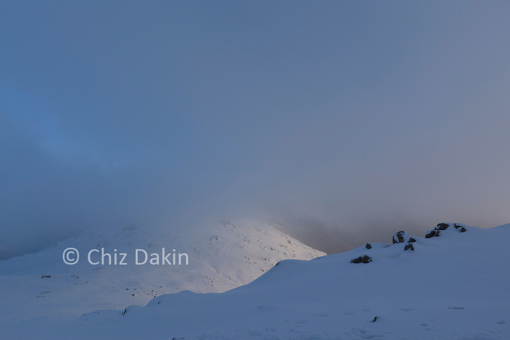 Fresh snow covering rocks on the NW ridge of Esk Pike (Allen Crags in the background)