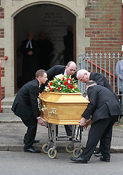 © Licensed to London News Pictures. 22/03/2016. Belfast, Northern Ireland, UK. The coffin of murdered prison officer Adrian Ismay to Woodvale Methodist church. Mr Ismay died following a booby-trap bomb that exploded under his van in East Belfast on March 4th. Photo credit: Peter Morrison/LNP
