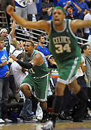 Boston Celtics forward Glen Davis, left, and teammate Paul Pierce celebrate after Davis scored the game-winning shot as time expired during Game 4 of a second round playoff game in Orlando, Fla., May 10, 2009.  The Celtics won 95-94.