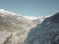 Aerial view of snowfall in the hills of vashisht area of Manali overlooking himalayan range of mountains of Himachal Pradesh, India.