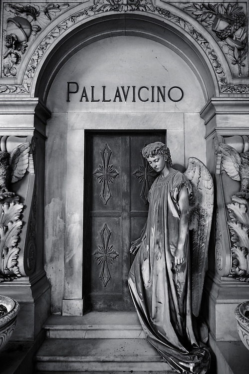 Heavens Gate - Black and white art photo of the stone sculpture of an angel at the doors of the Pallavicino Family tomb, sculpted by A Rivalta 1896. Section D no 27, the monumental tombs of the Staglieno Monumental Cemetery, Genoa, Italy .<br /> <br /> Visit our PEOPLE & PLACES PHOTO ART COLLECTIONS for more photos to buy as buy as wall art prints https://www.photoshelter.com/mem/images/index#/C00001WetsxVxNTo/ .<br /> <br /> Visit our LANDSCAPE PHOTO ART PRINT COLLECTIONS for more wall art photos to browse https://funkystock.photoshelter.com/gallery-collection/Places-Landscape-Photo-art-Prints-by-Photographer-Paul-Williams/C00001WetsxVxNTo