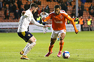 Blackpool forward Keshi Anderson (8) takes on Oxford United midfielder Anthony Forde (14) during the EFL Sky Bet League 1 match between Blackpool and Oxford United at Bloomfield Road, Blackpool, England on 21 May 2021.