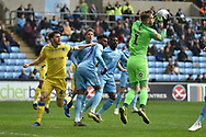 Coventry City goalkeeper Lee Burge (1) makes an important save during the EFL Sky Bet League 1 match between Coventry City and Bristol Rovers at the Ricoh Arena, Coventry, England on 7 April 2019.