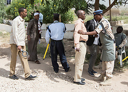 © Licensed to London News Pictures. 4/08/2015. Hargeisa, Somaliland.  A local policeman conducts a search on an attendee of the International Hargeisa Book Festival in the city of Hargeisa within the Republic of Somaliland this week (1 - 6 Aug). <br /> <br /> Over 700 guests are expected to attend along with renowned poets, writers and musicians from both Somaliland, Nigeria and the UK.  As well as the book fair the Women of the World (WOW) event, hosted by Jude Kelly, the Artistic Director of the Southbank Centre in London was held for the first time in the Horn of Africa.   Photo credit : Alison Baskerville/LNP