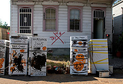 30 Oct, 2005.  New Orleans, Louisiana. Hurricane Katrina aftermath.<br /> Refrigerator dumping. Locals in the Marigny neighbourhood add their stinking appliances to others already lining the street. Halloween decorations appear on the doors. <br /> Photo; ©Charlie Varley/varleypix.com