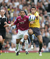 Photo: Paul Thomas.<br /> West Ham United v Arsenal. The Barclays Premiership. 24/09/2005.<br /> <br /> West Ham's Hayden Mullins competes with Robin Van Persie for the ball.
