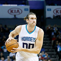 03 November 2015: Charlotte Hornets forward Spencer Hawes (00) looks to pass the ball during the Charlotte Hornets  130-105 victory over the Chicago Bulls, at the Time Warner Cable Arena, in Charlotte, North Carolina, USA.
