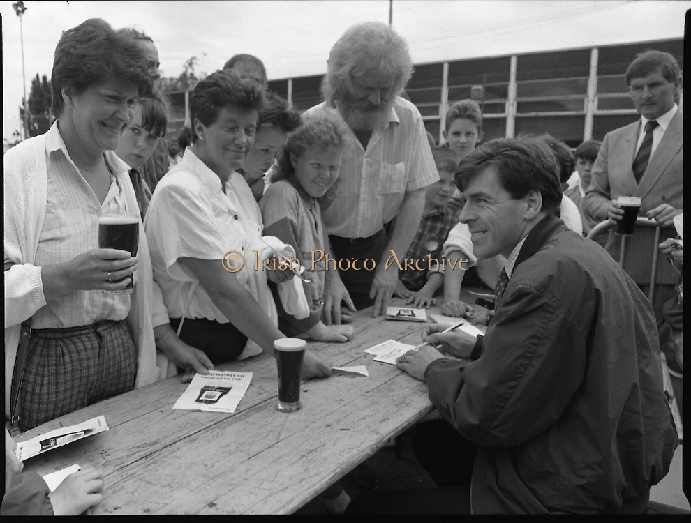"""Guinness Family Day At The Iveagh Gardens. (R83)..1988..02.07.1988..07.02.1988..2nd  July 1988..The family fun day for Guinness employees and their families took place at the Iveagh Gardens today. Top at the bill at the event were """"The Dubliners"""" who treated the crowd to a performance of all their hits. Ireland's penalty hero from Euro 88, Packie Bonner, was on hand to sign autographs for the fans...Packie Bonner is pictured signing autographs for the fans after his heroics at Euro 88."""