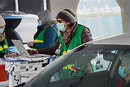 Registered nurse Vivian Foulke works at a station during a COVID-19 drive-through vaccination clinic put on by Lehigh Valley Health Network on Jan. 27, 2021, at Dorney Park in Allentown, Pennsylvania. Community members 75 and older were eligible to receive their first dose with an appointment ahead of time. (Photo by Matt Smith)