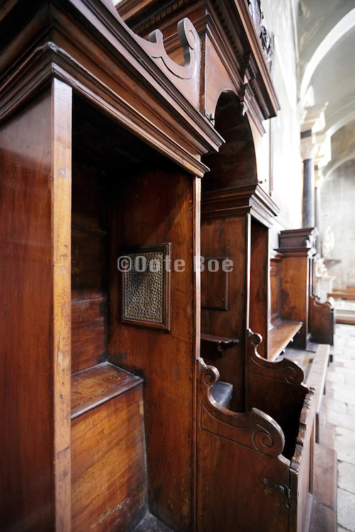 confessional in side aisle of church Italy
