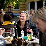 Middle-class Russians enjoy wine on a late afternoon at the Coffee Mania street cafe on Bolshaya Nikitskaya in Moscow.