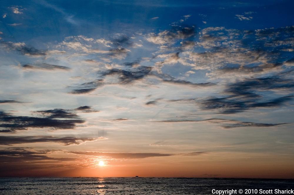 A beautiful Waikiki sunset on the Pacific Ocean.