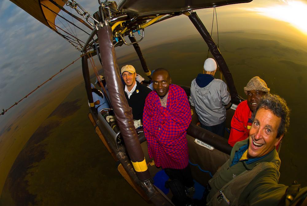 Blaine Harrington (on right) photographing from a hot air balloon over Masai Mara National Reserve, Kenya