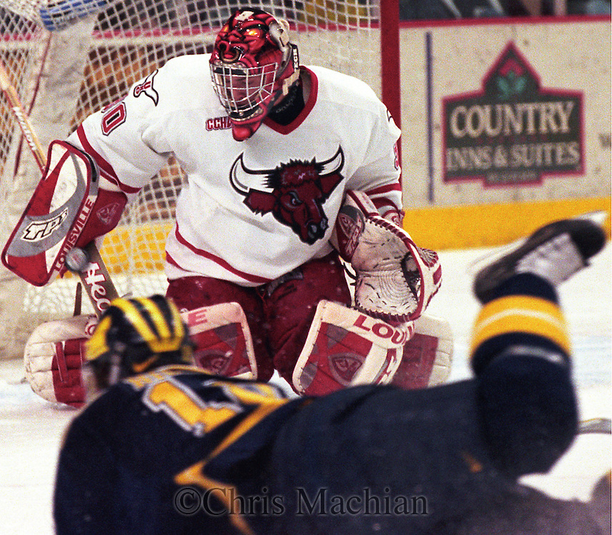 University of Nebraska at Omaha's Dan Ellis blocks a shot during last years series split with Michigan.<br /> (photo by Chris Machian/Prairie Pixel Group)