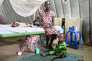 """Mcc0075406 . Daily Telegraph<br /> <br /> DT Foreign<br /> <br /> Hellen Apuok with her sons Emmanuel 2.5 yrs and Juan 2 months  old .<br /> The IMC Paediatric ward in POC 3 , a """"Protection of Civilian Camp"""" inside the vast UN compound on the outskirts of Juba . Parents bring their children in with acute malnutrition needing urgent treatment .<br /> <br /> Over 20,000 civilians who predominantly fled from conflict in the equatorial states of South Sudan . United Nation's agencies recently announced a famine in the war torn country .<br /> <br /> Juba 27 February 2017"""