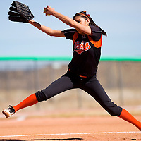 030113       Cable Hoover<br /> <br /> Gallup Bengal Kianna Spencer (11) pitches to the St. Pius Spartans Saturday at Gallup High School.