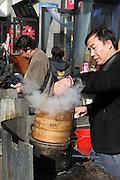 China, Beijing, Busy pedestrian street market Food Vendor