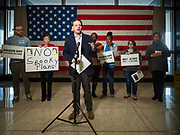 """31 OCTOBER 2019 - DES MOINES, IOWA: MATT SINOVIC, Executive Director of Progress Iowa, speaks against proposed Republican changes to the Affordable Care Act during a protest in the Neil Smith Federal Building in Des Moines. A small crowd of people came to the federal building, where US Senators Chuck Grassley's (R-IA) and Joni Ernst's (R-IA) offices are, to deliver a petition protesting the Senate's vote that critics say would allow """"spooky junk health insurance plans"""" with limited coverage and would allow insurance companies to deny coverage to people with pre-existing conditions.          PHOTO BY JACK KURTZ"""