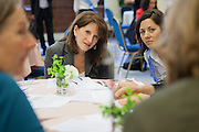 Lyne Featherstone MP in discussion with her constituants at the Tea time for change event. Refreshing the call for justice. Organised by the UK's leading NGO's.  Enabling constituents to dicuss the subject with their MP.