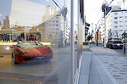 luxury car dealer showroom display with a red Ferrari sports car