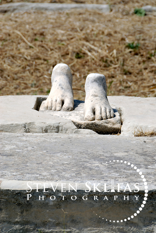 Iraion. Samos. Greece. Two feet that is the only remaining fragments of an ancient statue or sculpture. Heraion is the main sanctuary of ancient Samos and is located on the southeast coast, 6 km kilometres from Pythagoreio.