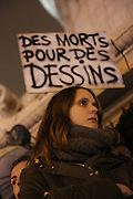 """A placard reads """"Deaths for Drawings"""" A massive public demonstration took place in Place de la Republique, in central Paris, France; the evening after armed gunmen attacked the offices of Charlie Hebdo, killing twelve people, including the editor and celebrated cartoonists; four more are in critical condition. It is the dealiest terror attack in France for over fifty years. Charlie Hebdo is a satirical publication well known for its political cartoons. <br /><br />As a solidarity actions with the deaths at Charlie Hebdo many placards read """"Je suis Charlie"""" translating as """"I am Charlie (Hebdo)"""". Demonstrators held aloft pens, brushes and crayons, symbolizing the profession of journalists and cartoonists who were killed. Many pens were placed in a shrine with candles in the square"""