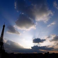 Europe, France, Paris. Eiffel Tower against a dramatic sky.