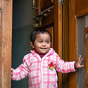 Young girl in doorway of home in Jodhpur