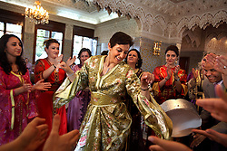 Relatives dance at the wedding of Meryem Benanine, 32, and Nabil Abou et Ainine, 33, who were married in a traditional ceremony arranged by their families in Casablanca, Morocco on May 9, 2009.