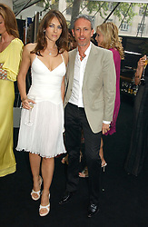 LIZ HURLEY and PATRICK COX at the 2006 Glamour Women of the Year Awards 2006 held in Berkeley Square Gardens, London W1 on 6th June 2006.<br /><br />NON EXCLUSIVE - WORLD RIGHTS