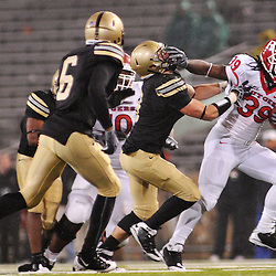 Oct 23, 2009; West Point, N.Y., USA; Rutgers running back Jourdan Brooks (39) straight-arms a defender during Rutgers' 27 - 10 victory over Army at Michie Stadium.