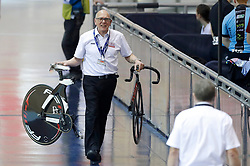 A marshal carries a broken bike after a crash betweenTeam Wales rider Rachel James and Chloe Jones in the 1st round of The Women's Keirin, during day two of the HSBC UK National Track Championships at The National Cycling Centre, Manchester.