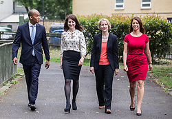© Licensed to London News Pictures. 20/07/2015. London, UK. Labour leadership contender Liz Kendall (second left) with Chuka Umunna (far left), Emma Reynolds (second right) and  Gloria De Piero (far right) at Roupell Park Estate in Brixton to talk about renewable energy. Photo credit : James Gourley/LNP