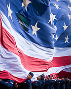 Airmen from the Hanscom Air Force Base roll down the American Flag before the Boston Red Sox's game against the Baltimore Orioles at Fenway Park in Boston, Massachusetts on Monday, April 15 2019.<br /> <br /> Credit: Cameron Pollack / Boston Red Sox
