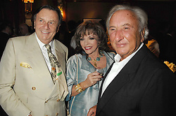 Left to right, BARRY HUMPHRIES, JOAN COLLINS and MICHAEL WINNER at a party to celebrate the 180th Anniversary of The Spectator magazine, held at the Hyatt Regency London - The Churchill, 30 Portman Square, London on 7th May 2008.<br /><br />NON EXCLUSIVE - WORLD RIGHTS
