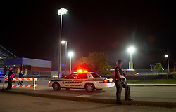 August 18, 2018 - Wellington, Florida, U.S. - Police block the entrance to Palm Beach Central high School. Two adults were shot Friday night at a football game between Palm Beach Central and William T. Dwyer high schools, authorities said. The gunfire sent players and fans screaming and stampeding in panic during the fourth quarter of the game at Palm Beach Central High School in Wellington, Florida on August 17, 2018. (Credit Image: © Allen Eyestone/The Palm Beach Post via ZUMA Wire)